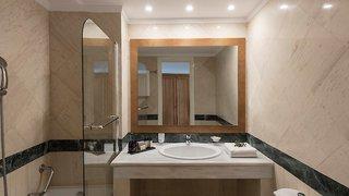 Hotel Mitsis Rinela Beach Resort & Spa Badezimmer